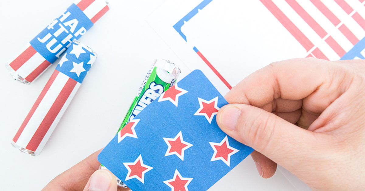 Apply American flag labels to rolls of mints/candy