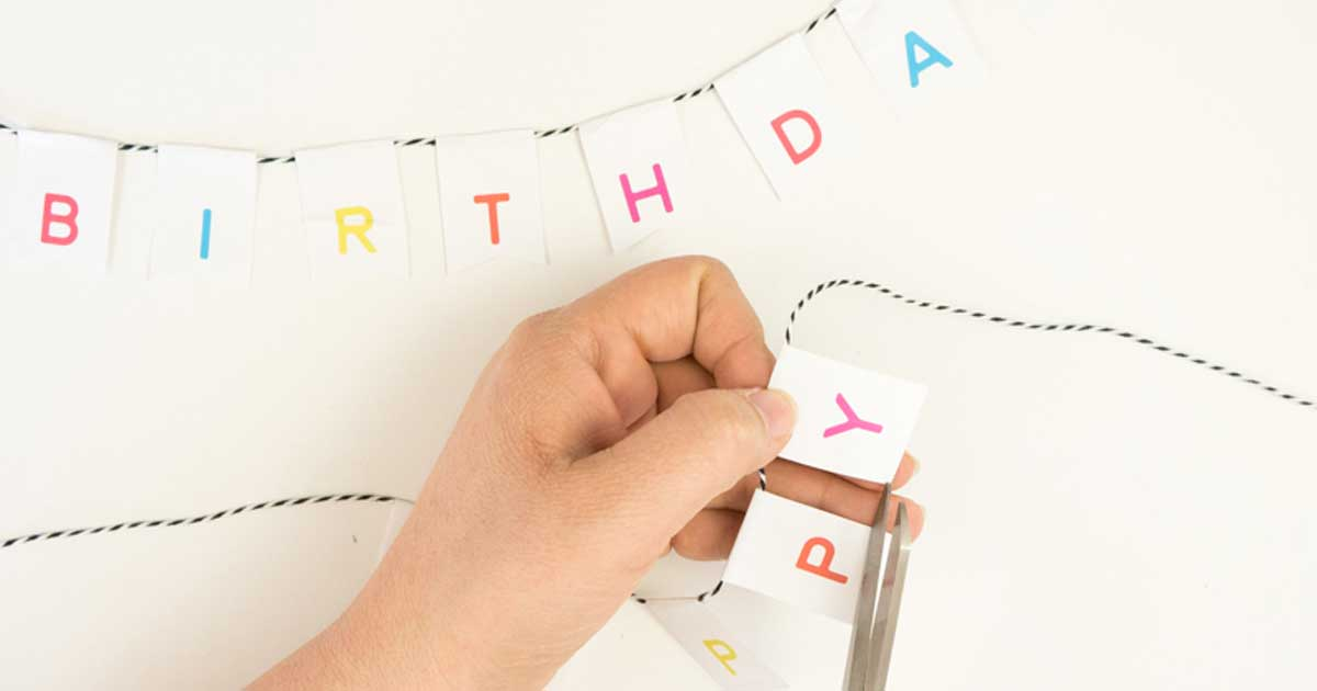DIY birthday banner tutorial: Cut the label into a pennant shape