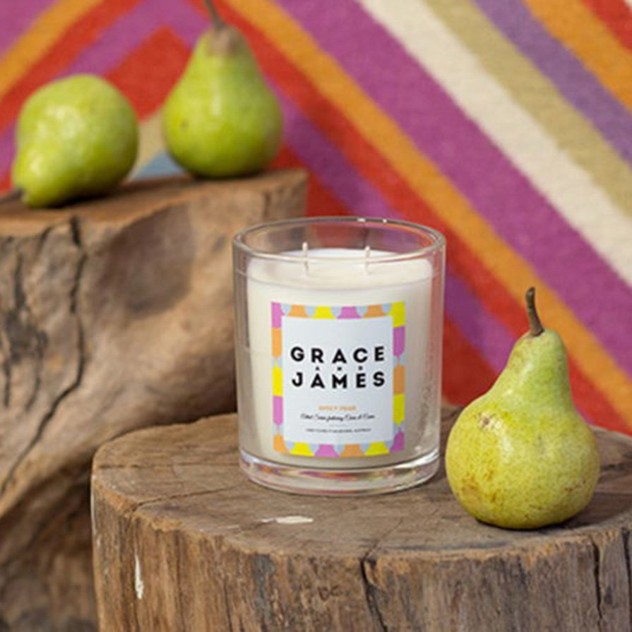 Fun, colorful candle label design on small glass jar