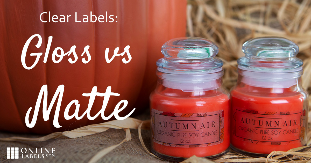 Clear matte labels and clear gloss labels side-by-side on clear glass candle jars