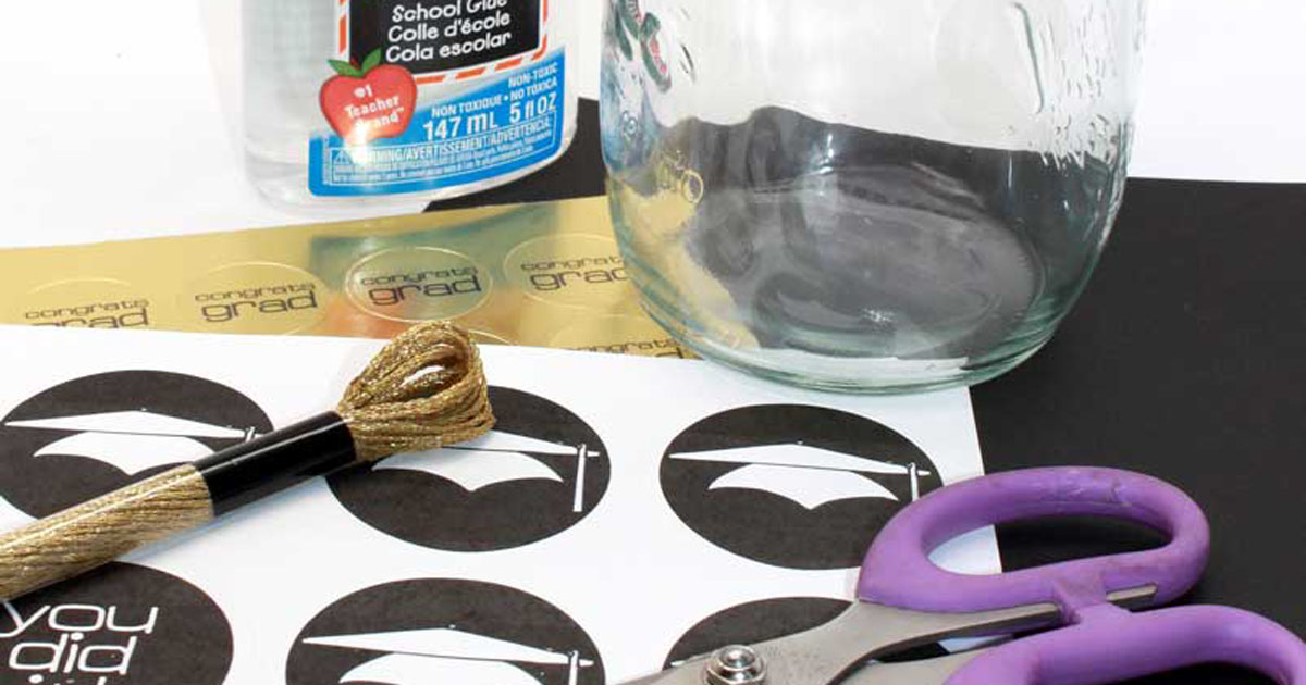 All the supplies needed to create a money-filled graduation gift/favor jar