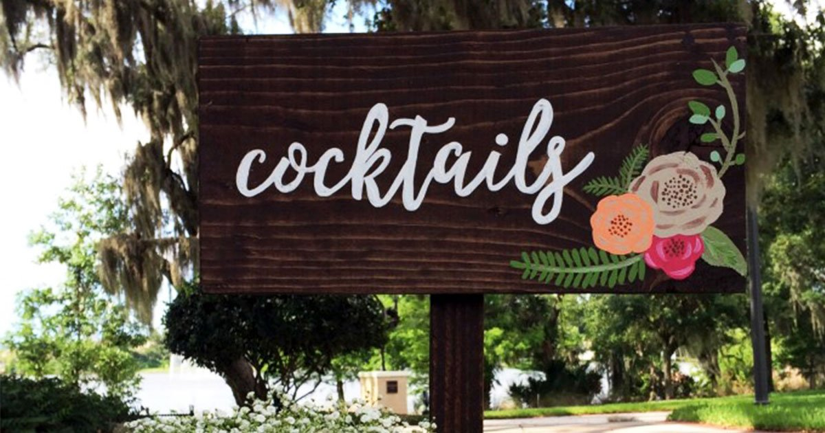 DIY outdoor calligraphy wedding sign to point guests to the bar