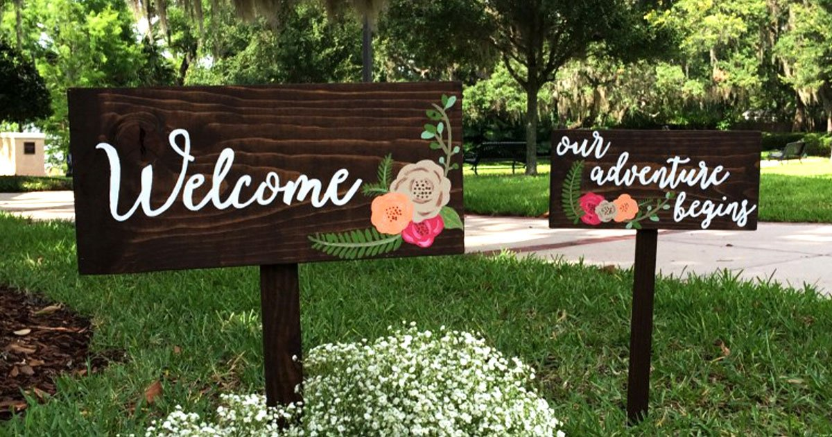 "DIY outdoor calligraphy wedding signs: ""welcome"" and ""our adventure begins"""