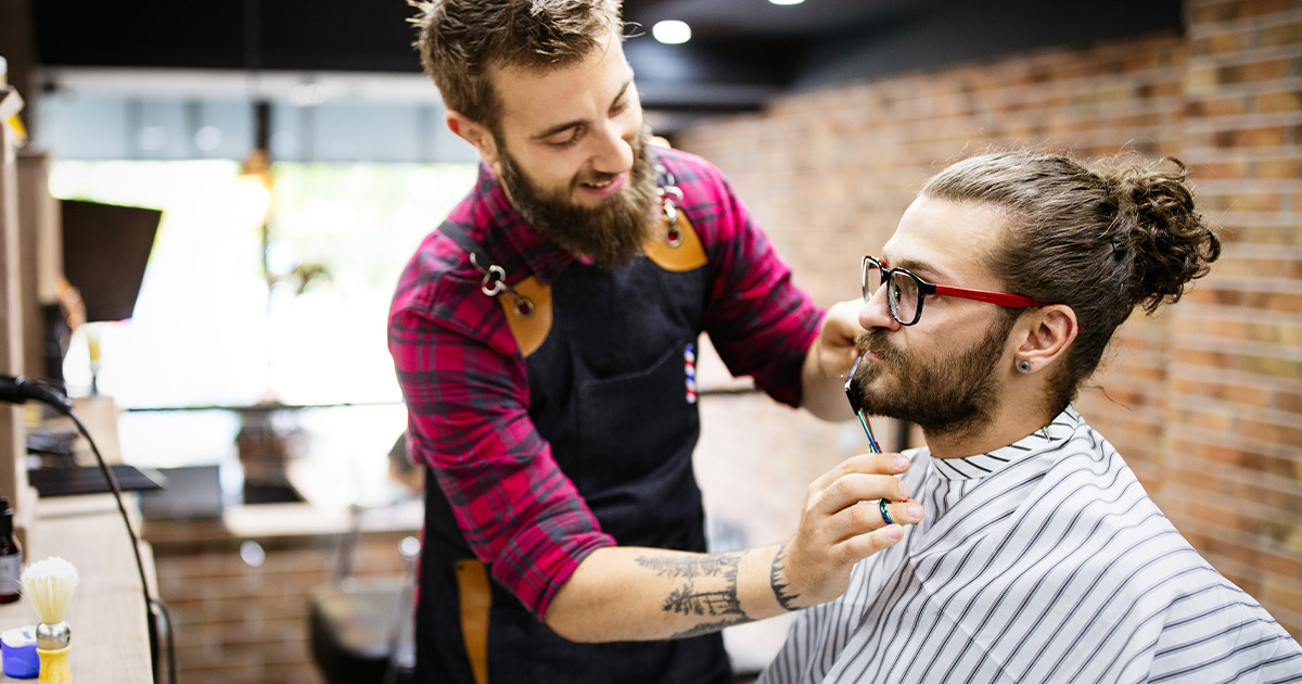 Barber providing grooming services