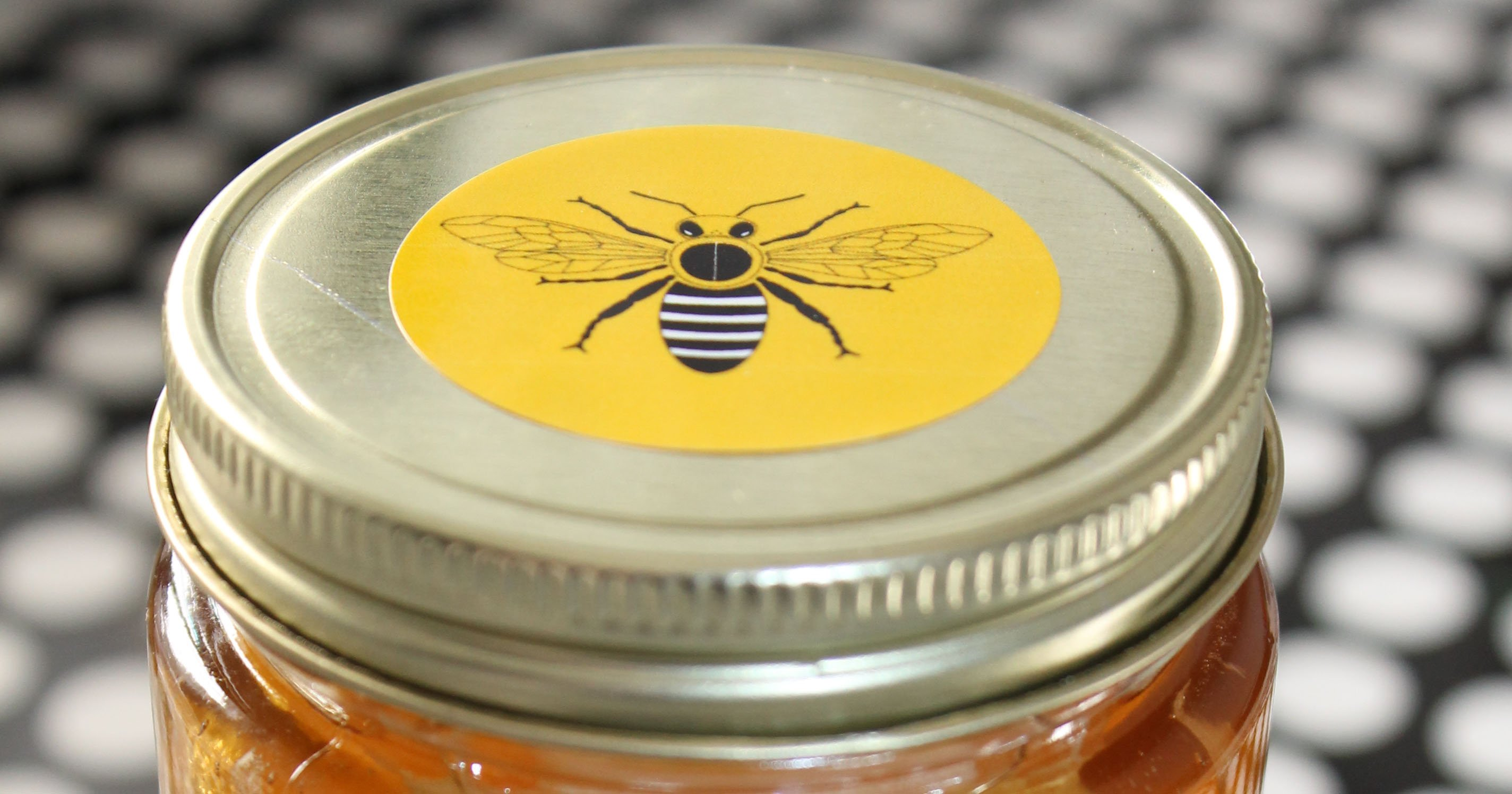Honey jar with printable sticker attached to lid