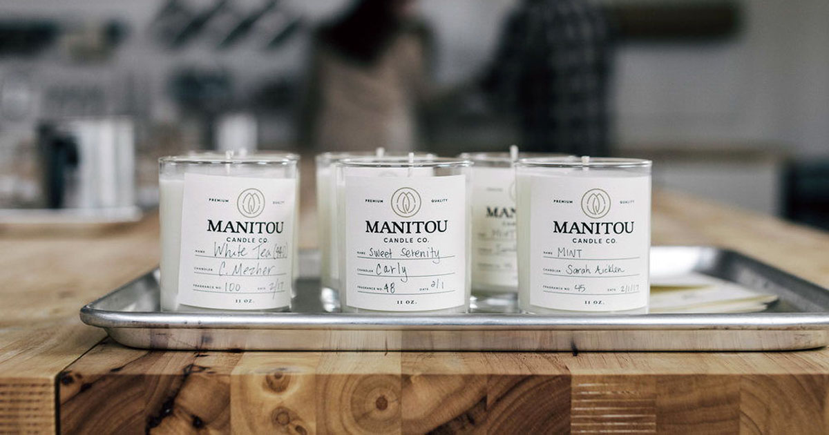 Glass candle jar with white product label where you hand-write in the scent and other details