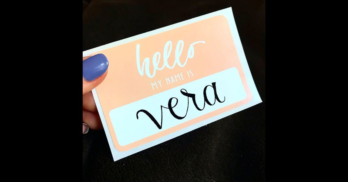 """Name tag example, pulled from @moonlitdesignco: simple, """"hello my name is"""" name tag sticker in pastel pink/salmon with calligraphic name"""