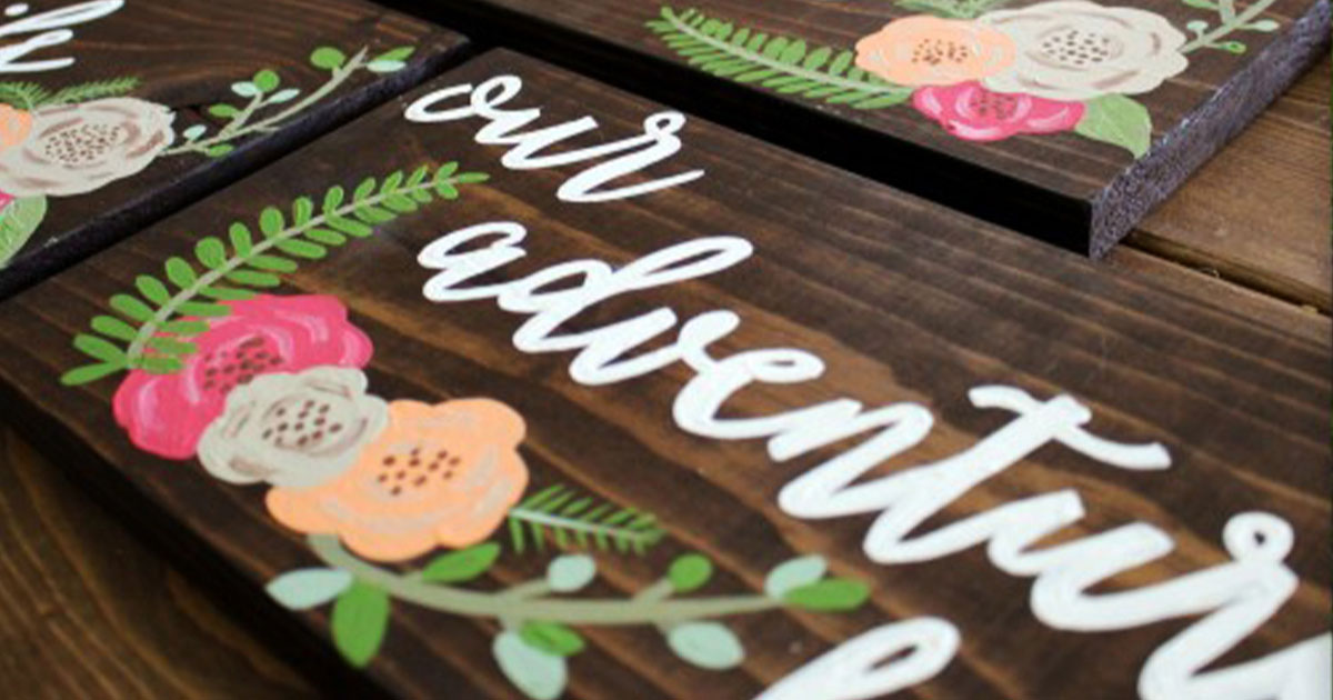 DIY outdoor calligraphy wedding sign with floral design