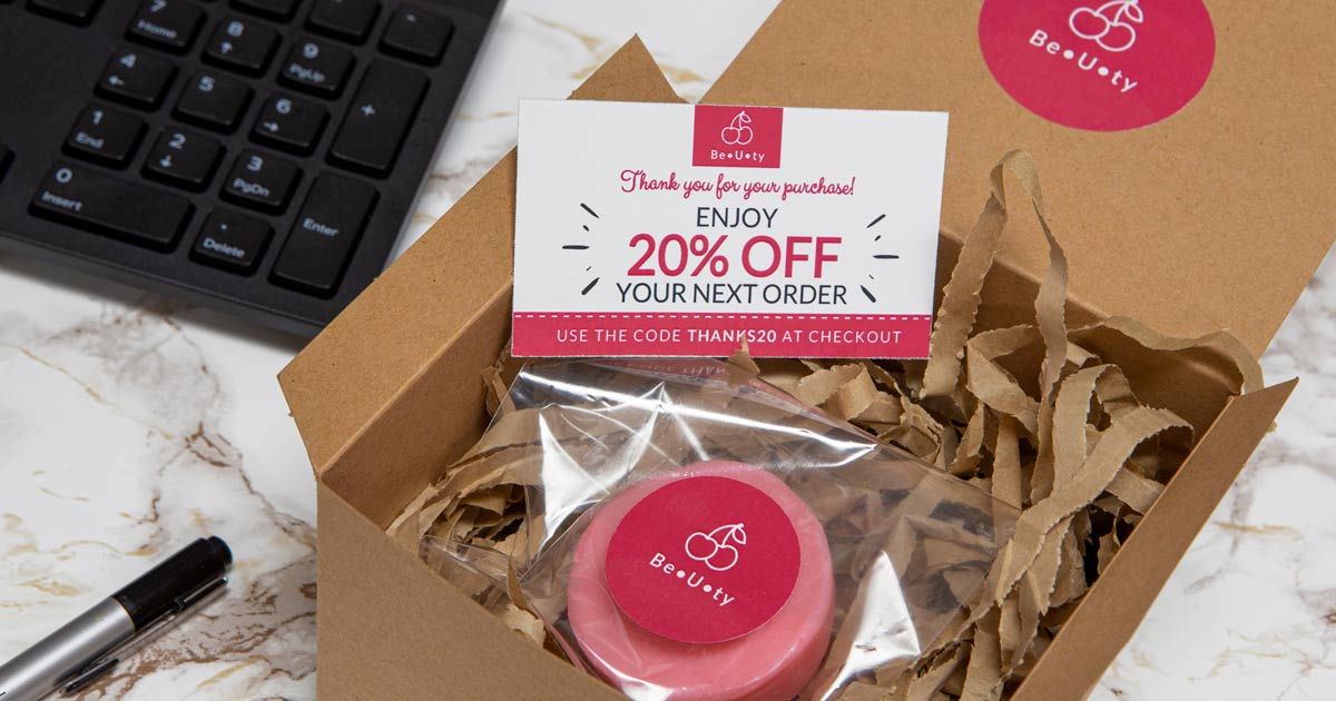 Small business order shipment with product packaging insert included, offering 20% your next purchase