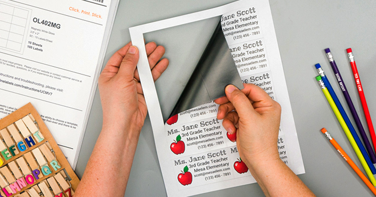 Peeling printable magnets from their perforated sheet for teacher contact hand-outs