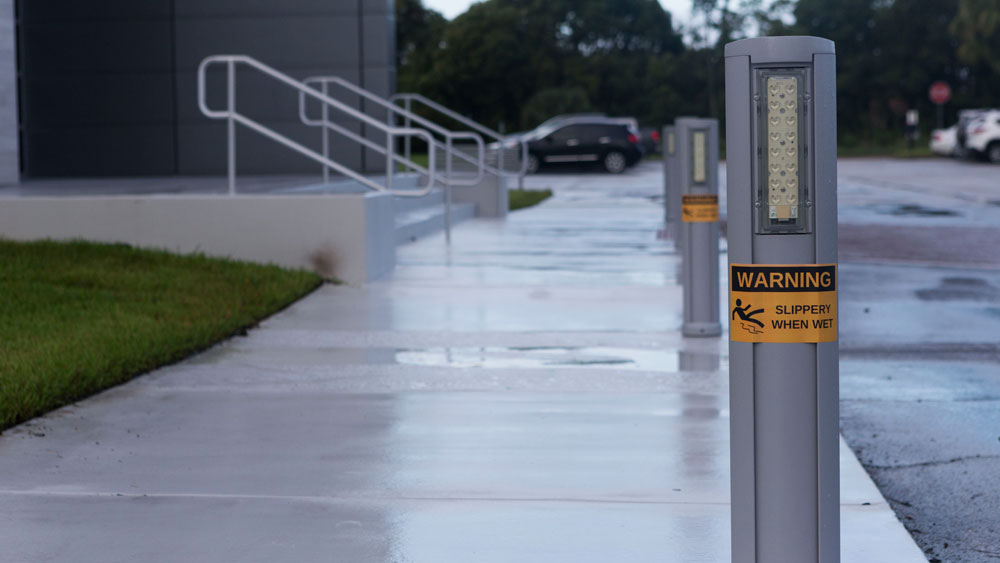 """Slippery when wet"" pillars with weatherproof labels"