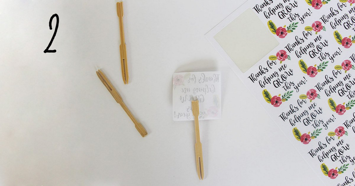 "How to assemble your ""thanks for helping me grow"" printable label template on sticks to add to a flower pot for your child's teacher, step 2"