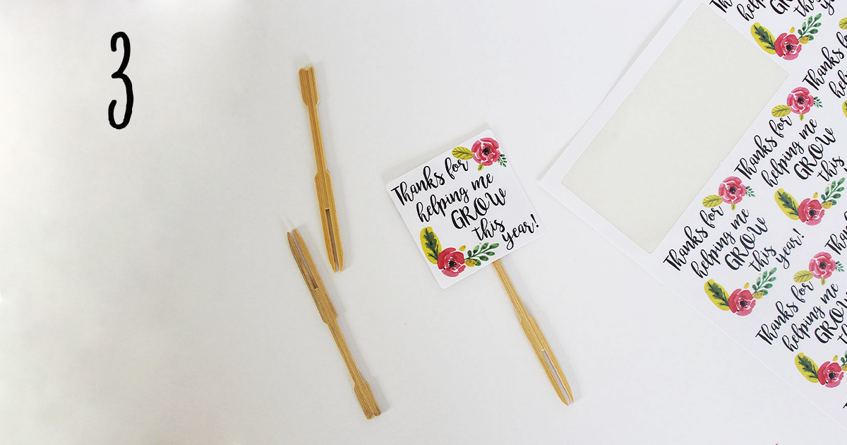 "How to assemble your ""thanks for helping me grow"" printable label template on sticks to add to a flower pot for your child's teacher, step 3"