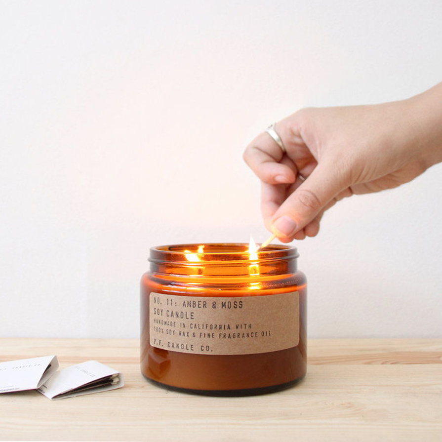 Amber candle jar with brown kraft label and simple typewriter font