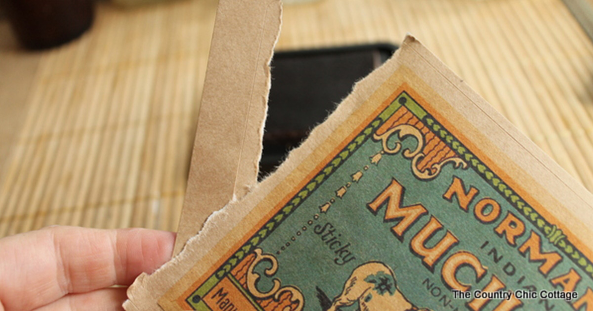 Tear or cut the edges of your label to make it look worn and tattered